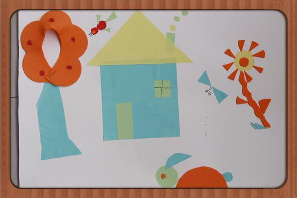 """精心设计""""我是小巧手""""实践活动,鼓励孩子们用圆形,半圆形,方形,三角形"""